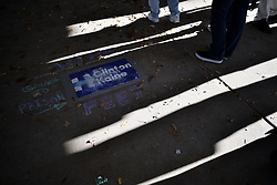 Attendees wipe there feet on a Clinton sign outside a rally with Donald Trump, in Central Pennsylvania, at the Giant Center, in Hershey, PA., on Fri. Nov. 4, 2016.