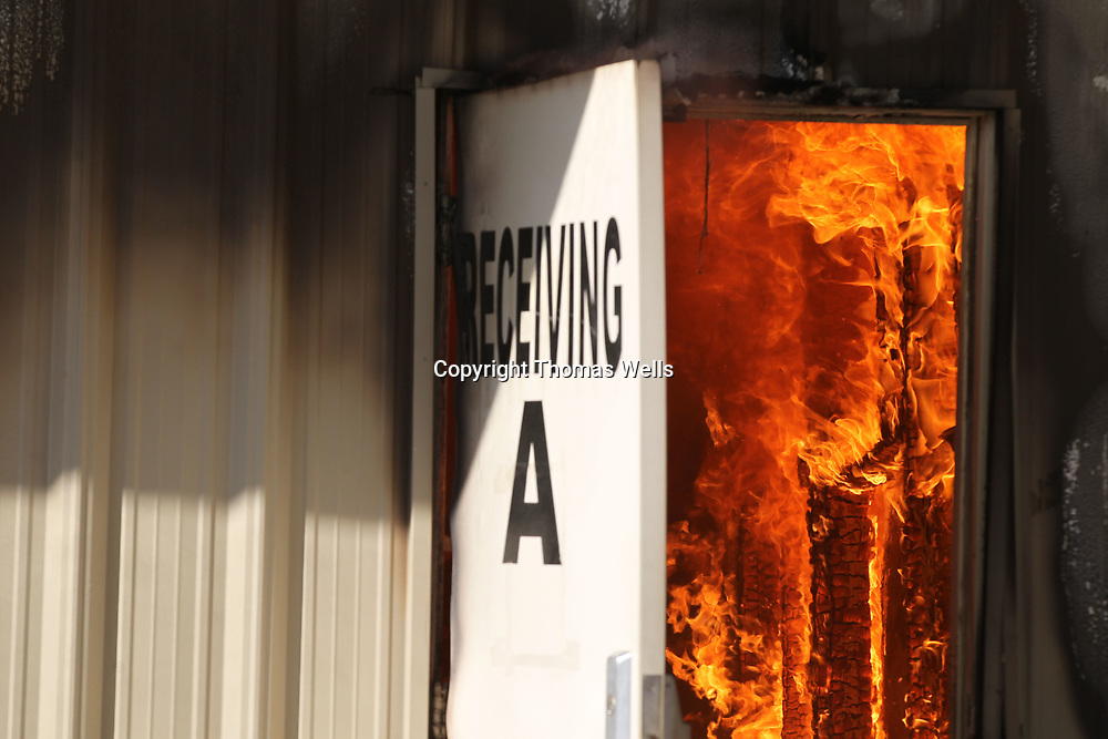 Fire completely englufs buildings at American Furniture in Ecru Friday morning. The blaze destoyed much of the facility.