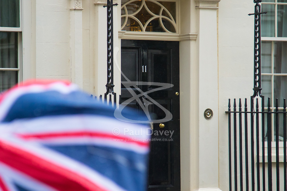 Downing Street, London, March 8th 2017. Chancellor of the Exchequer Philip Hammond emerges from his official residence and office at number 11 Downing Street to pose with his red briefcase before leaving for Parliament to present his 2017-2018 budget.