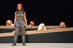 © Licensed to London News Pictures. 21/10/2013. Theatre Royal Stratford East presents Crowning Glory, a new play by Somalia Seaton that seeks to reveal a hidden world of unobtainable beauty by asking the question, how do women truly see themselves in today's world?Picture features Lorna Brown (Panther) and members of the cast. Photo credit: Tony Nandi/LNP.