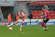 James Coppinger (26) of Doncaster Rovers  and Harry Beautyman (16) of Peterborough United  during the Sky Bet League 1 match between Doncaster Rovers and Peterborough United at the Keepmoat Stadium, Doncaster, England on 19 March 2016. Photo by Ian Lyall.