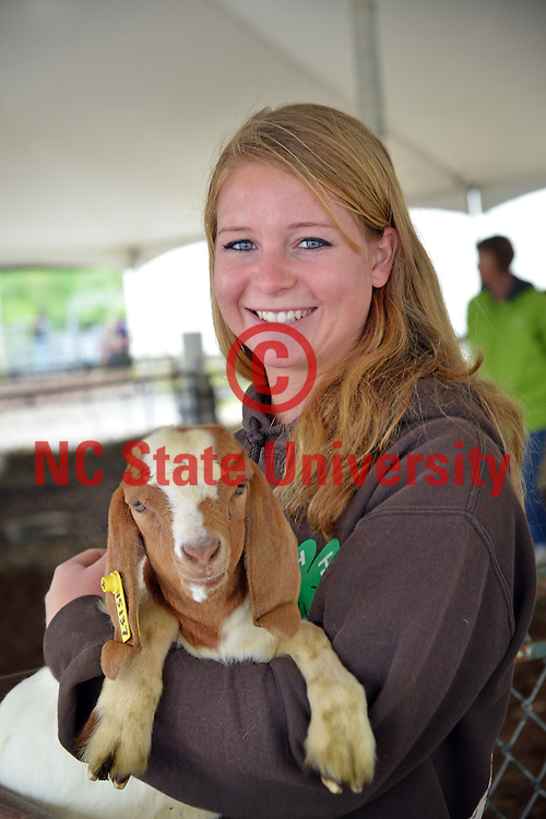 Student and her goat during Farm Animal Days.