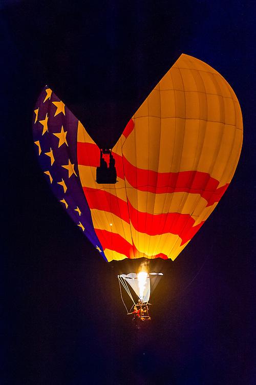 Dawn patrol (hot air balloons flying before sunrise), Albuquerque International Balloon Fiesta, Albuquerque, New Mexico USA.