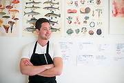 05/20/2015- Somerville, Mass. - Theo Friedman, A15, poses for a portrait in his apartment kitchen on May 20, 2015. As an undergraduate, Friedman would prepare a variety of dinners for his friends and other guests. (Kelvin Ma/Tufts University)