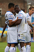 Ade Azeez of AFC Wimbledon celebrates with Lyle Taylor of AFC Wimbledon after his opener during the Sky Bet League 2 match between York City and AFC Wimbledon at Bootham Crescent, York, England on 24 October 2015. Photo by Stuart Butcher.