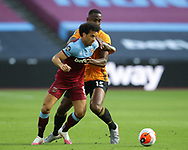 Felipe Anderson of West Ham United holds off Willy Boly of Wolverhampton Wanderers during the Premier League match at the London Stadium, London. Picture date: 20th June 2020. Picture credit should read: David Klein/Sportimage
