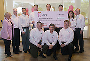"The KFC Leadership Team with the check given to representatives of Susan G. Komen for the Cure® on Monday, Aug. 23, 2010 in Louisville, Ky. The more than $4.2 million donation is a result of the chain's ""Buckets for the Cure(TM)"" campaign and is the single largest donation in the history of Susan G. Komen for the Cure. (Photo by Brian Bohannon)."