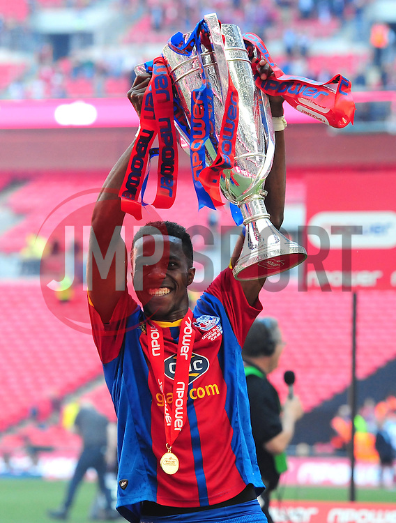 Crystal Palace's Wilf Zaha celebrates with the trophy - Photo mandatory by-line: Joe Meredith/JMP - Tel: Mobile: 07966 386802 27/05/2013 - SPORT - FOOTBALL - CHAMPIONSHIP - PLAY OFF - FINAL - Wembley Stadium - London - Crystal Palace V Watford