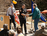 Lieutenant Kris Kelley shares a couple of stories with the crowd as he congratulates Morgan Sheldon for his 40 years of service to the Town of Gilford Friday afternoon.  (Karen Bobotas/for the Laconia Daily Sun)