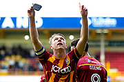 Bradford City defender Anthony McMahon (29) scores his second goal and celebrates to make the score 3-0 during the EFL Sky Bet League 1 match between Bradford City and AFC Wimbledon at the Coral Windows Stadium, Bradford, England on 22 April 2017. Photo by Simon Davies.