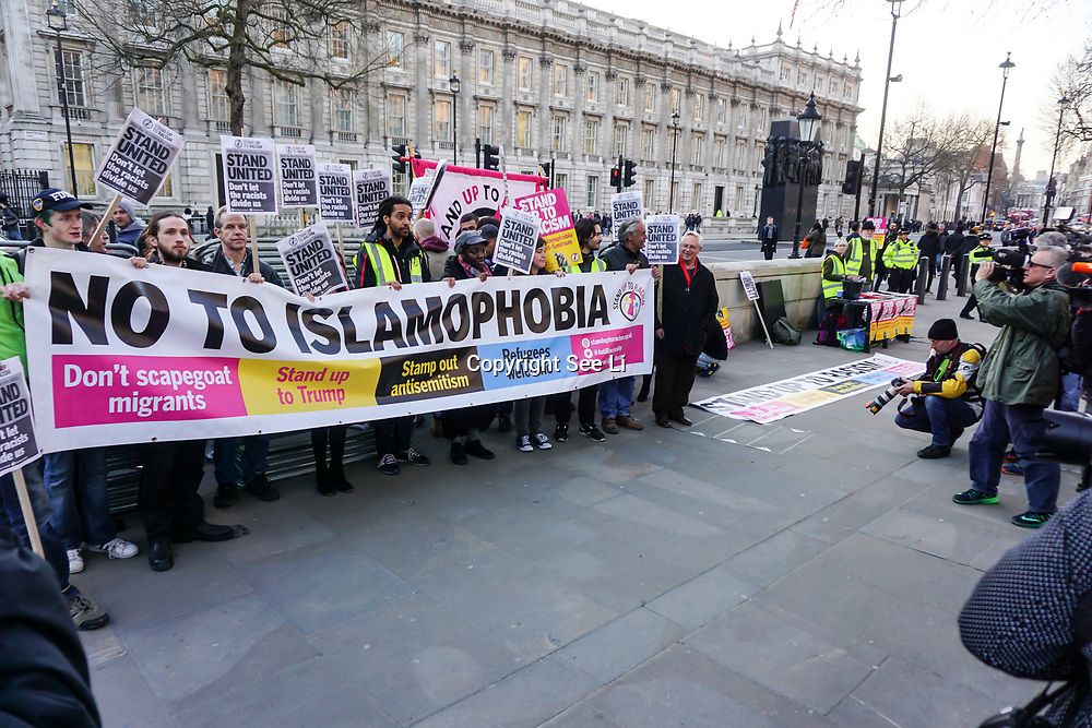 London,England,uk, 24th March 2017: Stand Up To Racism hosts a Unity vigil against hatred and division. We must not be divided No to Islamophobia outside Downing Street in London,UK. by See Li