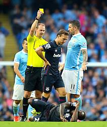 Aleksandar Kolarov of Manchester City receives a yellow card  - Mandatory byline: Matt McNulty/JMP - 07966 386802 - 19/09/2015 - FOOTBALL - City of Manchester Stadium - Manchester, England - Manchester City v West Ham United - Barclays Premier League