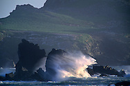 Windswept waves crash on coastal rocks near Crescent City, Del Norte County, California