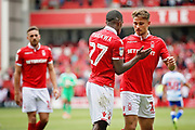 Nottingham Forest midfielder Matthew Cash (14)  and Nottingham Forest defender Tendayi Darikwa (27)   celebrate after the EFL Sky Bet Championship match between Nottingham Forest and Reading at the City Ground, Nottingham, England on 11 August 2018.