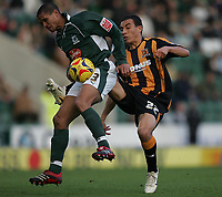Photo: Lee Earle.<br /> Plymouth Argyle v Hull City. Coca Cola Championship. 09/12/2006. Hull's Craig Fagan (R) battles with Mathias Kouo-Doumbe.