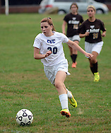 FAIRLESS HILLS, PA -  OCTOBER 3: Conwell Egan's Lindsay Straka (30) dribbles the ball as she is chased by St. Hubert's defenders during a girls soccer game October 3, 2013 in Fairless Hills, Pennsylvania.  (Photo by William Thomas Cain/Cain Images)