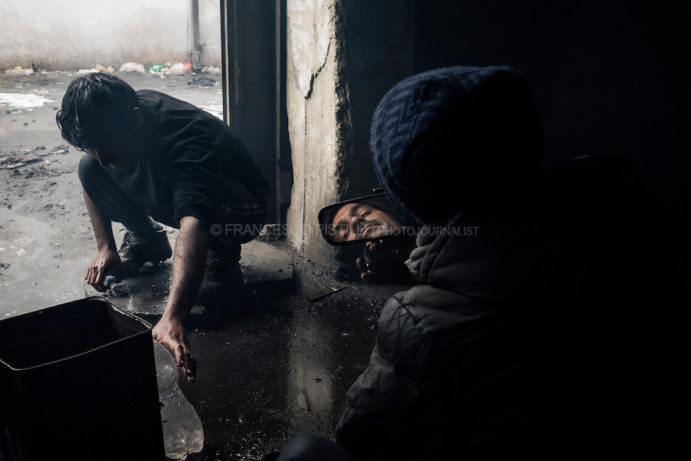 Hundreds of migrants and refugees stranded in Serbia are occupying a derelict warehouse in Belgrade.