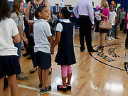 """Students meet with their tutors at a celebration of the """"Help Me Read"""" program at Enrico Fermi Elementary School No. 17 in Rochester on Monday, June 2, 2014. The tutoring program helped 137 children improve their reading ability, with some students making jumps of several grade levels in one year."""