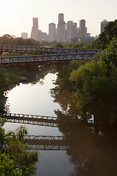 Sunrise over the Rosemont Bridge and Buffalo Bayou with Houston, Texas skyline.