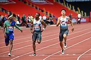 Michael Rodgers (USA) left, winning his heat of the men's 100m in a time of 10.16 ahead of Yohan Blake (JAM) centre, and Zhenye Xie (CHN) during the Birmingham Grand Prix, Sunday, Aug 18, 2019, in Birmingham, United Kingdom. (Steve Flynn/Image of Sport via AP)