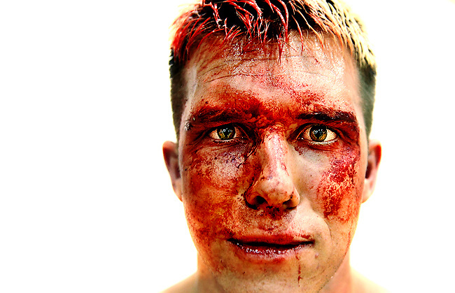 """Derrick Hubbard, known as """"Derrick Jannetty"""" in the ring poses after a bloody match against """"Radical Ricky,"""" during Nightmare on Vine, an NWA-Ultra Championship Wrestling-Zero event, at South Valley Boys and Girls Club in Murray, Utah, Saturday, Oct. 3 2009. Hubbard was defeated in an """"I Give Up"""" match. . .PATRICK SMITH/Daily Herald"""