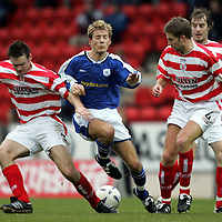 St Johnstone v Hamilton Accies..06.11.04<br />Lee Hardy is stopped by Mark McLaughlin and Steven Thomson<br />Picture by Graeme Hart.<br />Copyright Perthshire Picture Agency<br />Tel: 01738 623350  Mobile: 07990 594431