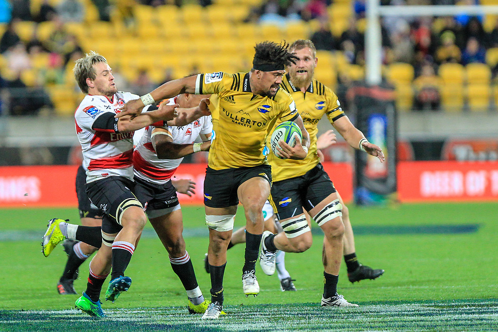 Ardie Savea breaks through a tackle during the Super rugby (Round 12) match played between Hurricanes  v Lions, at Westpac Stadium, Wellington, New Zealand, on 5 May 2018.  Hurricanes won 28-19.