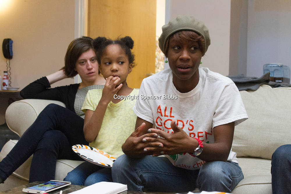 "Neighborhood resident and community organizer, LaKeisha Hamilton led a discussion Sunday afternoon in a series of discussions organized by Hamilton to address the rise in local violence and the lack of resources for at risk youth.<br /> <br /> 2370 – LaKeisha Hamilton speaks as her daughter, Anaiya and Mathilde Gerbelli listen.<br /> <br /> Please 'Like' ""Spencer Bibbs Photography"" on Facebook.<br /> <br /> All rights to this photo are owned by Spencer Bibbs of Spencer Bibbs Photography and may only be used in any way shape or form, whole or in part with written permission by the owner of the photo, Spencer Bibbs.<br /> <br /> For all of your photography needs, please contact Spencer Bibbs at 773-895-4744. I can also be reached in the following ways:<br /> <br /> Website – www.spbdigitalconcepts.photoshelter.com<br /> <br /> Text - Text ""Spencer Bibbs"" to 72727<br /> <br /> Email – spencerbibbsphotography@yahoo.com"