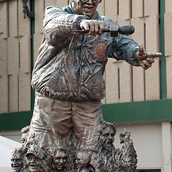 """Harry Caray statue at Wrigley Field. Harry Caray was a very popular announcer for the Chicago Cubs and is known for leading fans in singing """"Take Me Out to the Ball Game"""" during the seventh inning stretch."""