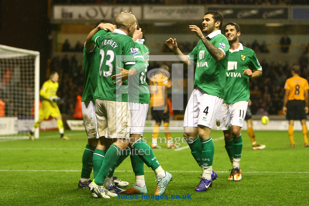 Picture by Paul Chesterton/Focus Images Ltd.  07904 6402672.20/12/11.Simeon Jackson of Norwich scores his sides 2nd goal from a cross by Steve Morison and they both celebrate during the Barclays Premier League match at Molineux Stadium, Wolverhampton.