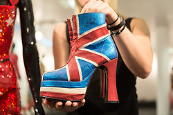© Licensed to London News Pictures. 26/07/2018. London, UK.  A pair of boots worn by Geri Halliwell are on display at the Spice Girls exhibition. The interactive exhibition features hundreds of iconic stage, music video and film costumes worn by the popular 90s girl band at Business Design Centre/Photo credit: Ray Tang/LNP
