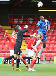 Peterborough United's Tyrone Barnett out-jumps Crewe's goalkeeper Steve Phillips  - Photo mandatory by-line: Joe Dent/JMP - Tel: Mobile: 07966 386802 07/09/2013 - SPORT - FOOTBALL -  Alexandra Stadium - Crewe - Crewe Alexandra V Peterborough United - Sky Bet League One