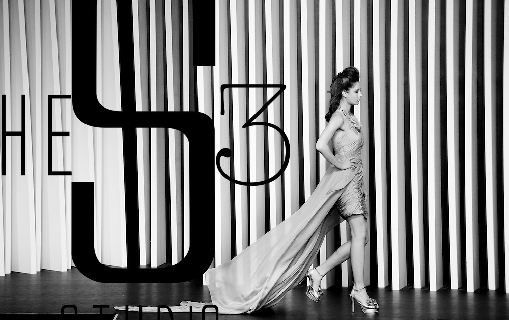 HONG KONG - JULY 06:  (EDITORS NOTE: Image has been converted to black and white.) A model displays a creation of Benten during the 'Lady Macaroon' show as part of the Hong Kong Fashion Week Spring/Summer 2011 at the Hong Kong Convention and Exhibition Center on July 6, 2010 in Hong Kong, China.  Photo by Victor Fraile / studioEAST