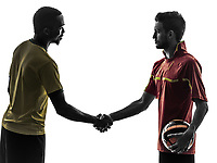 two men soccer player playing football competition handshake handshaking in silhouette on white background