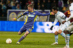 Robert Beric #32 of Maribor and Lionel Scaloni #5 of S.S. Lazio during football match between NK Maribor and S. S. Lazio Roma  (ITA) in 6th Round of Group Stage of UEFA Europa league 2013, on December 6, 2012 in Stadium Ljudski vrt, Maribor, Slovenia. (Photo By Gregor Krajncic / Sportida)