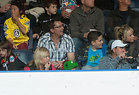 KELOWNA, CANADA - OCTOBER 10:  A fan's hat provides the illusion that a green dinosaur is watching as the Spokane Chiefs visit the Kelowna Rockets on October 10, 2012 at Prospera Place in Kelowna, British Columbia, Canada (Photo by Marissa Baecker/Shoot the Breeze) *** Local Caption ***