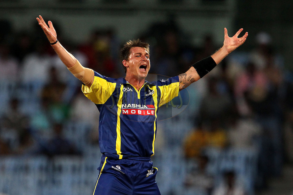 Dale Steyn celebrates the wicket of William Perkins during match 17 of the NOKIA Champions League T20 ( CLT20 )between the Cape Cobras and Trinidad and Tobago held at the M. A. Chidambaram Stadium in Chennai , Tamil Nadu, India on the 4th October 2011..Photo by Ron Gaunt/BCCI/SPORTZPICS