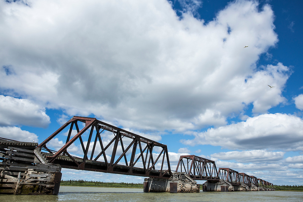Canada, Manitoba, Remains of railroad trestles above Nelson River at entrance to Hudson Bay
