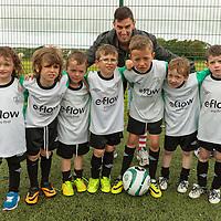 Casey Tuohy, Conor Flaherty, Ronan Garrihy, Jack Flaherty, Eoin Garrihy, James Danagher and Fionn Rush with coach Paul Kelly at the FAI Eflow Summer Soccer School Lisdoonvarna