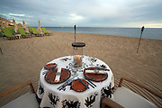 Romantic setting for a private dinner on the beach, with Pacific Ocean on your right, intimate resort on your left, protected by the Pedregal mountain on one side, and grasping the views to the end of Baja California Peninsula on the other side. From December to March you can also see the whales passing by!<br /> <br /> Romantic private dinner for two setting at Capella Pedregal Hotel &amp; Resort.