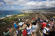 Honolulu. Tourists enjoying the view from the rim of Diamond Head Crater, an extinct volcano.