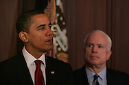 President Barack Obama makes a statement on the government procurement process in the Eisenhower Executive Office Building on March 4, 2009. Senator John McCain R-AZ is in background.  Photo by Dennis Brack