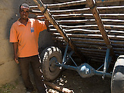"Keru Imam, 27 with the cart he has bought to take his seedlings for sale, Zwei, Ethiopia. ..Before Keru and his wife became involved in SEDA, an organisation working with Send a Cow, they didn't grow any fruit or vegetables and all they used to eat maize. As a result they used to get ill a lot. He now finds he has a lot more energy to work on the farm. During times of droughts he used to be forced to work as a labourer being paid 1 or 2 Birr a day, now he is starting to employee other people as labourers...""I am not afraid of drought because of what i have learnt."""