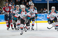 KELOWNA, CANADA - MARCH 23: Myles Bell #29 of the Kelowna Rockets skates to the bench to celebrate a goal against the Tri-City Americans on March 23, 2014 at Prospera Place in Kelowna, British Columbia, Canada.   (Photo by Marissa Baecker/Shoot the Breeze)  *** Local Caption *** Myles Bell; Damon Severson; Tyson Baillie; Marek Tvrdon;