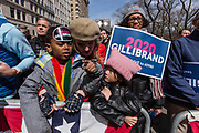 New York, NY - 24 March 2019. Senator Kirsten Gillibrand (D-NY) held a presidential campaign rally on New York's Central Park West in Front of the Trump Hotel  and Tower. A number of parents brought their children to the rally.