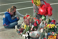 Kellie Lane, left, a 17-year-old junior and Amanda Mogensen, right, a 16-year-old junior  from Granite Bay High school mourn the loss of a classmate, Chris Lucia  at a makeshift memorial at Douglas Blvd and E. Roseville Pkwy. Thursday, February 15, 200.  Lucia, a senior at the school,  was killed in a single-car accident Saturday, February 10, 2001.  Students have been regularly attending the memorial site to grieve the death of their friend.