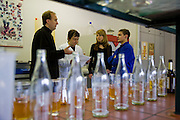 "Brewmaster Joachim Rösch speaks to lab workers who check the brewing process by sampling, at the Ganter Brewery in Freiburg im Breisgau, Germany.  (Joachim Rösch  is featured in the book What I Eat: Around the World in 80 Diets.) The caloric value of his day's worth of food in March was 2700 kcals. He is 44 years of age; 6 feet, 2 inches tall; and 207 pounds. Joachim's job requires him to taste beer a number of times during the week, and unlike in wine tasting, he can't just taste then spit it out: ""Once you've got the bitter on the back of your tongue, you automatically get the swallow reflex, so down the chute you go,"" he says. Joachim Rösch is MODEL RELEASED."
