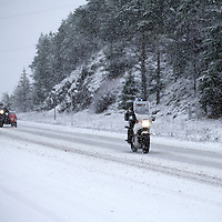 Motorcyclists battle the wintry weather on the A9 north of Bruar and Calvine today as the first serious snowfall of the winter hits Perthshire...07.12.14<br /> Picture by Graeme Hart.<br /> Copyright Perthshire Picture Agency<br /> Tel: 01738 623350  Mobile: 07990 594431