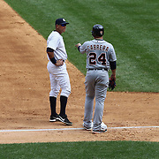 Alex Rodriguez, fielding at third base, talking with Miguel Cabrera on third during the New York Yankees V Detroit Tigers Major League Baseball regular season baseball game at Yankee Stadium, The Bronx, New York. 11th August 2013. Photo Tim Clayton