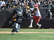 Sep 15, 2019; Oakland, CA, USA ;Kansas City Chiefs wide receiver Demarcus Robinson (11) catches a pass against Oakland Raiders defensive back Keisean Nixon (22) in the first half at Oakland-Alameda County Coliseum. The Chiefs defeated the Raiders 28-10..(Gerome Wright/Image of Sport)